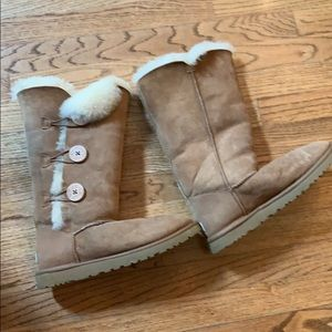 Brown fur lined high Ugg boots with buttons